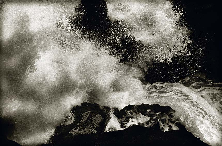 close up of exploding ocean wave on lava shore, infrared, black and white photograph, maui I, 2008 by William Oldacre