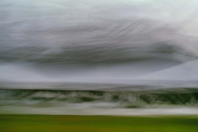 Light Signatures series, day, colour photograph, art, abstract, abstract expressionism, creative, city street, urban, downtown, cityscape, speed, blur, movement, motion, green, grey, muted, clouds, streaks, patterns