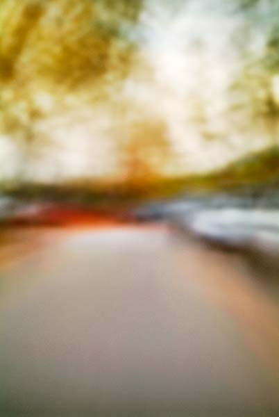 Convergent series, day, colour photograph, art, abstract, abstract expressionism, creative, city street, urban, downtown, cityscape, speed, blur, movement, motion, red, orange, yellow, muted, leaves, cars