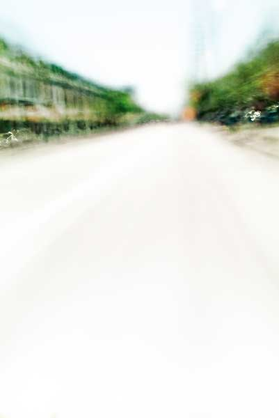 Convergent series, day, colour photograph, art, abstract, abstract expressionism, creative, city street, urban, downtown, cityscape, speed, blur, movement, motion, green, muted, wedges, shape