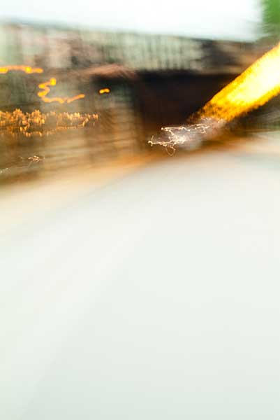 Convergent series, day, colour photograph, art, abstract, abstract expressionism, creative, city street, urban, downtown, cityscape, speed, blur, movement, motion, brown, yellow, muted, wedge, shape