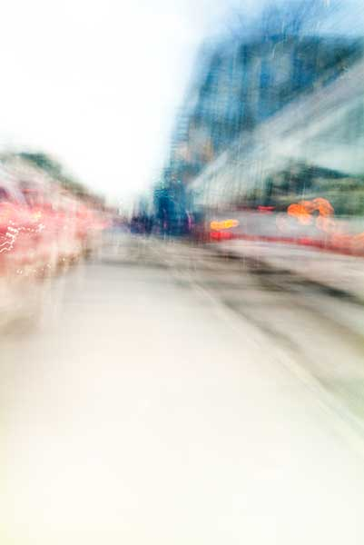 Convergent series, day, colour photograph, art, abstract, abstract expressionism, creative, city street, urban, downtown, cityscape, speed, blur, movement, motion, blue, green, red, orange, vibrant, wedge, shape