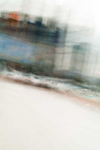 Convergent series, day, colour photograph, art, abstract, abstract expressionism, creative, city street, urban, downtown, cityscape, speed, blur, movement, motion, blue, orange, vibrant, wedge, shape