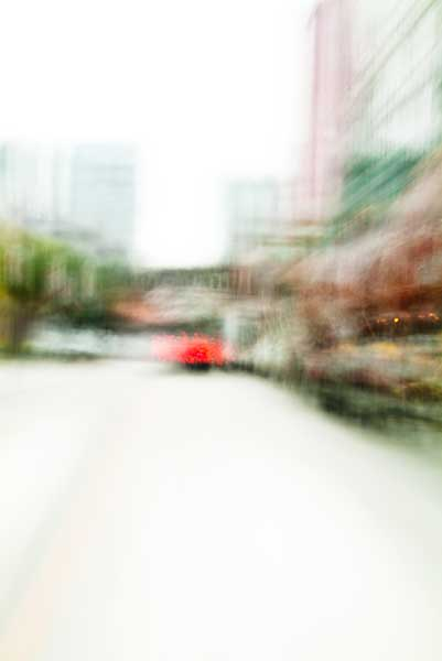 Convergent series, day, colour photograph, art, abstract, abstract expressionism, creative, city street, urban, downtown, cityscape, speed, blur, movement, motion, brown, green, red, vibrant, wedge, shape